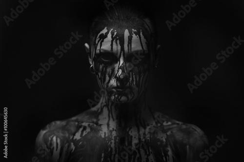 Canvas female demon.Art studio shot.Goth girl