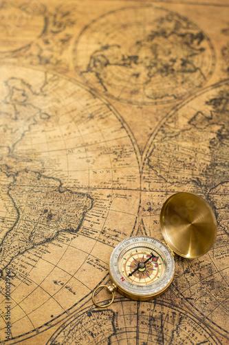 Valokuva old compass  on vintage map