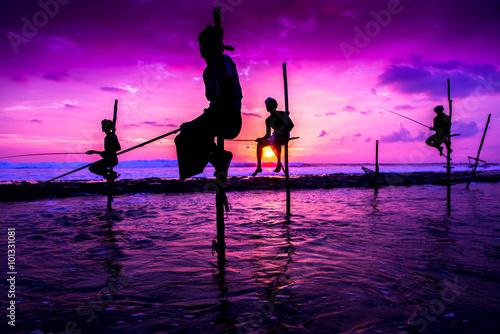 Canvas Print Stilt fisherman in Koggala, Sri Lanka