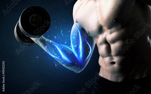 Photo Fit athlete lifting weight with blue muscle light concept