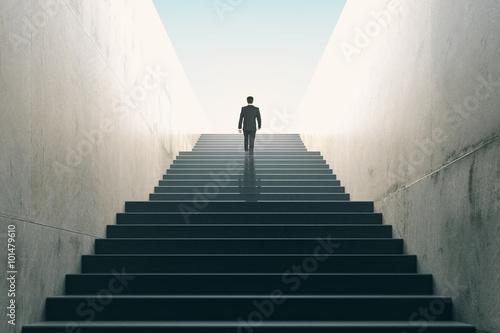 Slika na platnu Ambitions concept with businessman climbing stairs