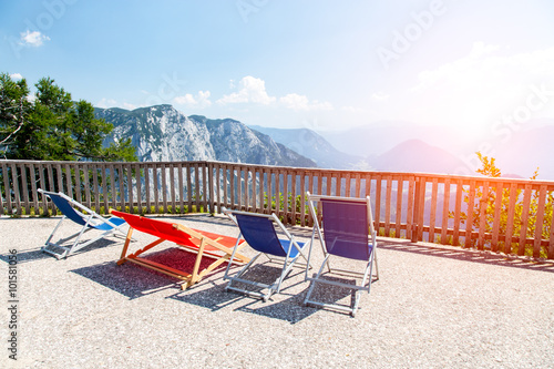 Fotografie, Tablou Sunset above the sunbeds in mountains