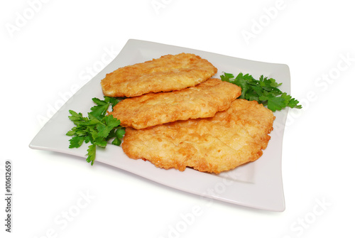 Obraz na plátně Fried Breaded Chicken Fillet in a Dish Isolated Against White Background