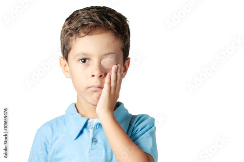 Fotografia Child with eye patch isolated on white background