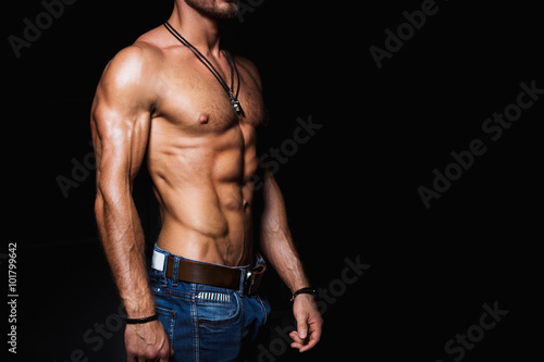 Canvas Print Muscular and sexy torso of young man in jeans