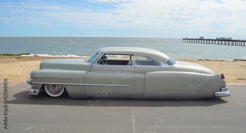 Fotografie, Obraz Classic Olds Pontiac Cadillac on Felixstowe seafront.