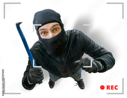Canvas Print Masked robber or burglar is recorded with security hidden camera