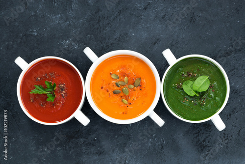 Canvas Print assortment of fresh vegetable soup on a dark background