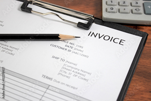 Invoice letter head on wood table / selective focus Fototapeta
