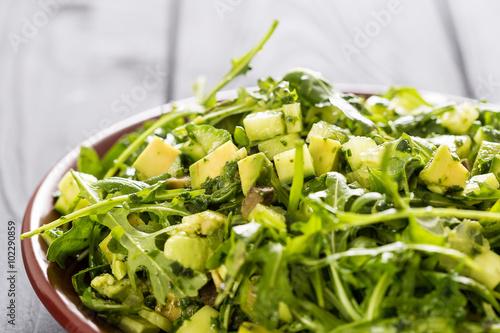 Obraz na płótnie Beautiful Paleo Green Salad with Cucumber and Avocado on a Dark Grey Wooden Back