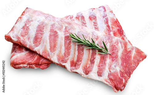 Fotografie, Obraz Raw  Pork ribs with a rosemary isolated on white