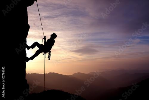 Obraz na płótnie Silhouette of Rock Climber at Sunset