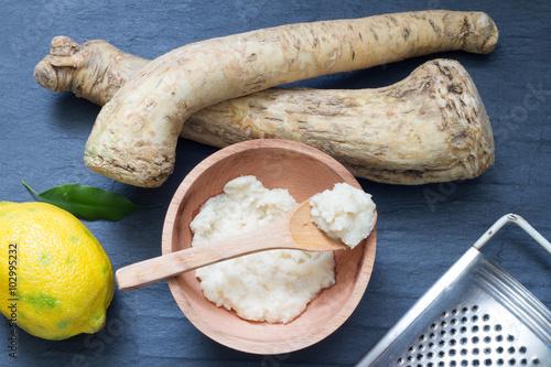 Fotografiet Raw horseradish and spices abstract still life