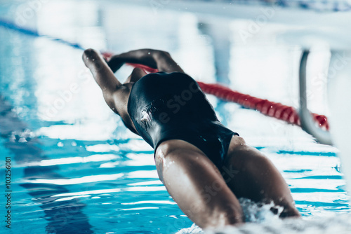 Canvas Print Backstroke swimming race start. Toned image