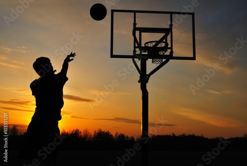 Wallpaper Mural Silhouette of Teen Boy shooting a Basketball