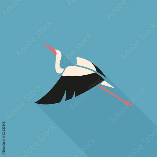 Fotografia flying white stork with black wing logo sign on blue background