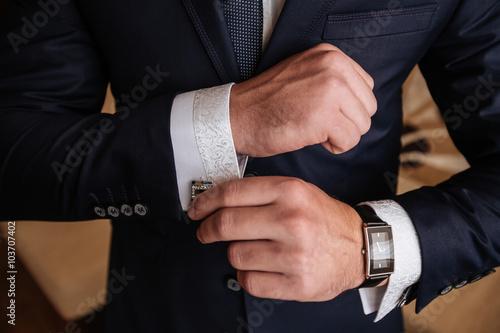 Fototapeta Mans hands with cufflinks. Elegant gentleman clother