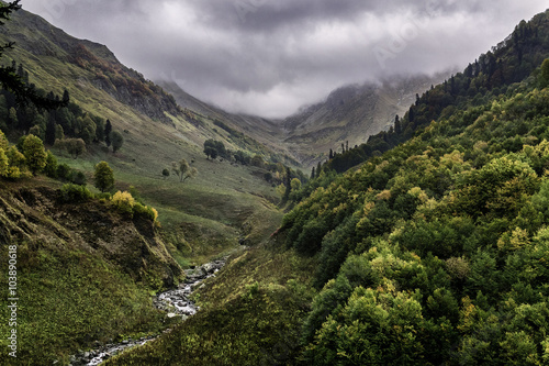 Fototapeta river valley in the Caucasus mountains in cloudy weather