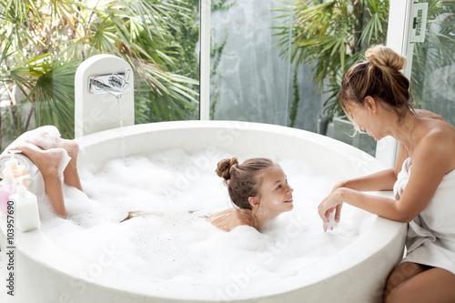 Fotografija Mother with a child washing in bath