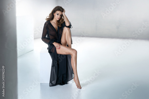 Sensual brunette posing in black dress
