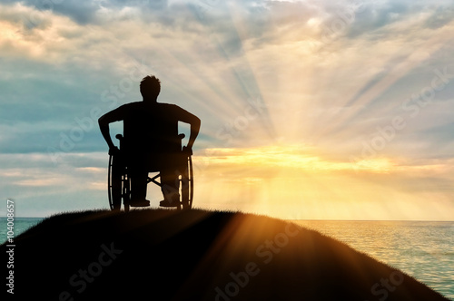 Silhouette of disabled person in a wheelchair Fotobehang