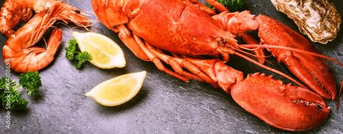 Obraz na plátně Fine selection of crustacean. Steamed lobster with lemon