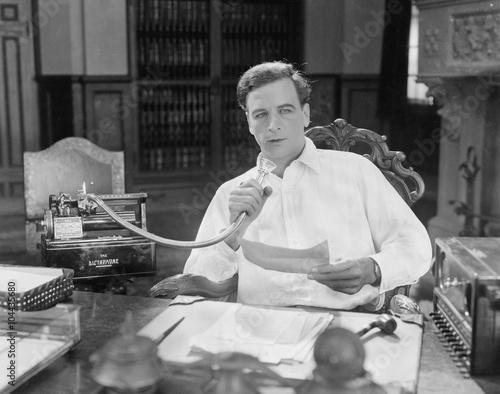 Fotografija Man reading into Dictaphone