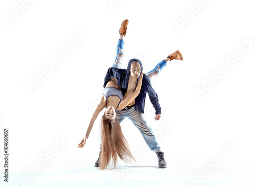 Canvas Print Strong hip-hop guy carrying his dance partner