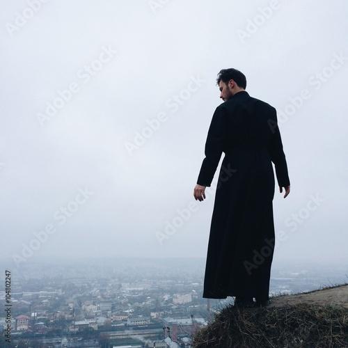 Fotografie, Obraz lonely priest on mountains