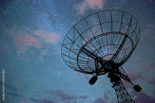 radar dish against cloud sky