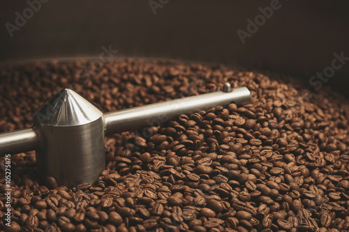 Slika na platnu beans freshly baked  hot inside roasting machine closeup