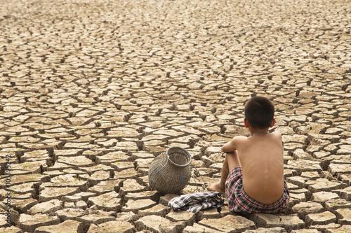 Canvas Print A lone children in the  arid area
