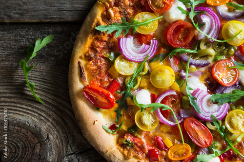 Canvas Print Pizza with arugula and cherry tomatoes
