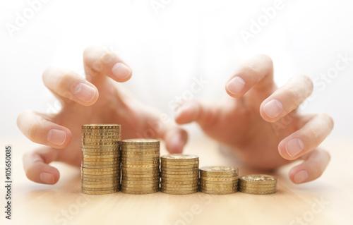 Fototapeta Greed for money. Hands grabbing coins.