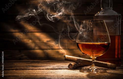 Whiskey with smoking cigar