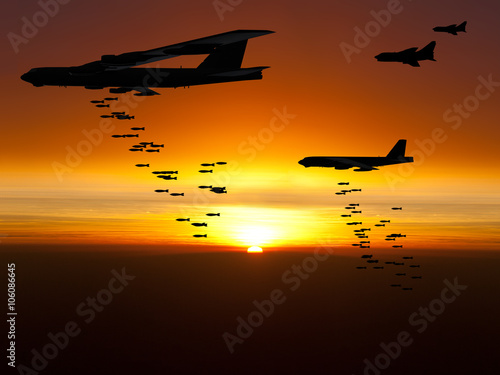 Obraz na plátne Vietnam War Era bombers dropping bombs with jet fighter aircraft escorting them at sunset