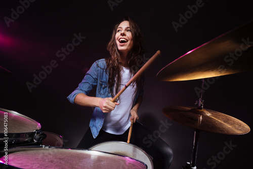Fotografering Woman playing the drums