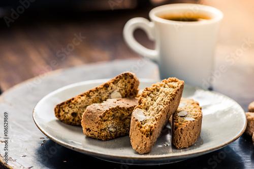 Slika na platnu Strong coffee served with italian cantucci