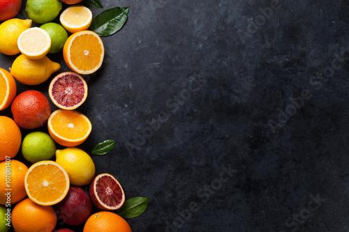 Foto Fresh citruses on dark stone