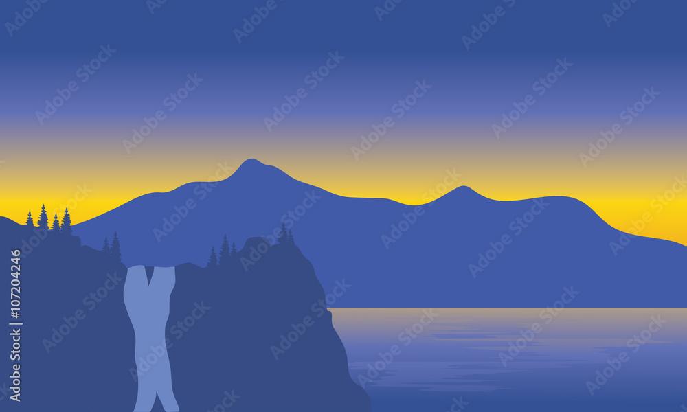 Silhouette of waterfall beside the sea <span>plik: #107204246   autor: wongsalam77</span>