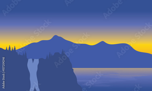 Silhouette of waterfall beside the sea