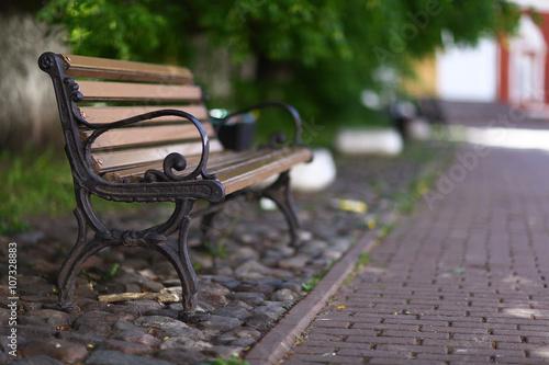 outdoor bench in city Fototapeta