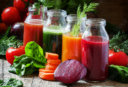 Four kind of vegetable juices: red, burgundy, orange, green, in