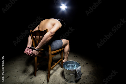 Prisoner being punished with cruel interrogation technique of waterboarding Fototapet