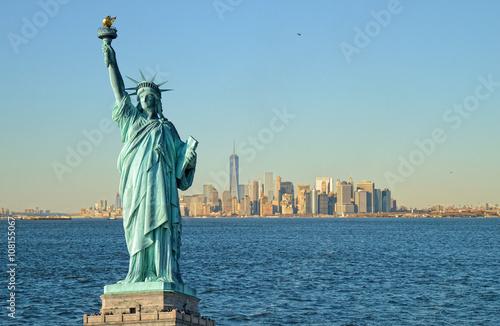 Photo Statue of Liberty and Manhattah skyline.