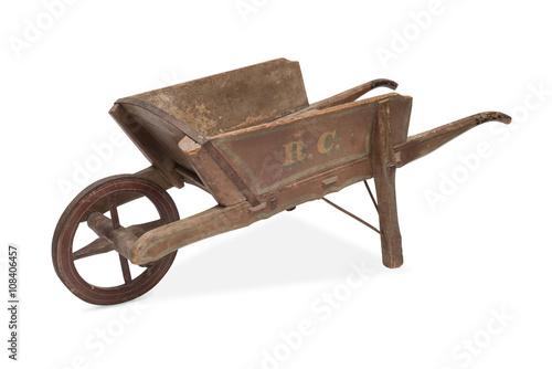 Photo An Antique Wheelbarrow