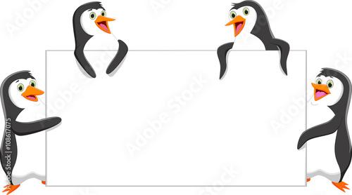 Fototapeta premium funny penguin cartoon with a blank sign