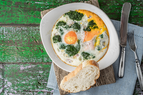 Wallpaper Mural Florentine eggs with pureed spinach on the wooden table horizontal