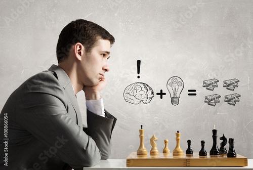 Obraz na plátně Hraje jeho obchodní strategie