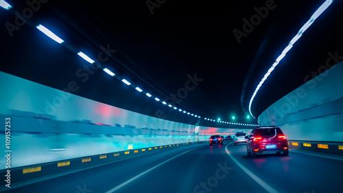Canvas-taulu car driving through tunnel